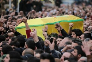Lebanese Hezbollah supporters carry the coffin of militant Jihad Mughniyeh during his funeral in a southern Beirut suburb on January 19, 2015. Iran confirmed today that a general of its elite Revolutionary Guards died in an Israeli strike on Syria that also killed six members of Lebanese militant group Hezbollah. AFP PHOTO /JOSEPH EID / AFP PHOTO / JOSEPH EID
